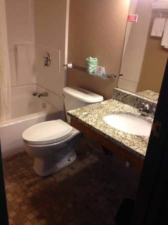 Home Place Inn: Rm#121 Double Queen Beds with Kitchenette, new granite bathroom sink and stone tile bathroom flo