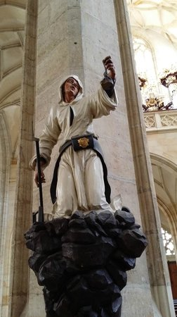 Cathedral of St. Barbara: the miner inside a church