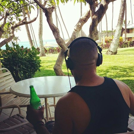 Napili Shores Maui by Outrigger: Hubby enjoying the Oceanview from the patio.
