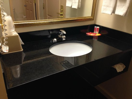 Econo Lodge At Six Flags: Sink and mirror.  Includes ice bucket, cups, and soap.  All super clean.