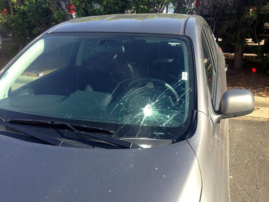 Holiday Inn Sioux City: Some unfortunate soul had their windshield smashed in the parking lot