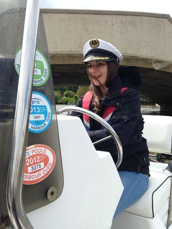 Poole Boat Hire: The hen, expertly steering the boat!