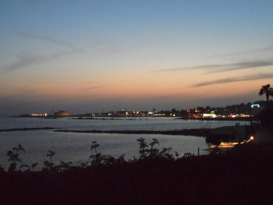 Almyra Hotel: Evening view across to Paphos harbour