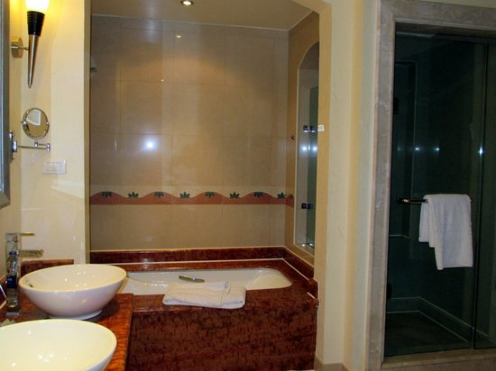Premier Le Reve Hotel & Spa (Adults Only) : Great bathroom - bath tub with shower, separate shower cubicle, toilet, bidet & two washbasins.