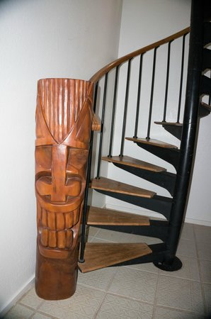 Aston at Poipu Kai : Lots of tiki statues--the spiral staircase went to the upper floor bedroom