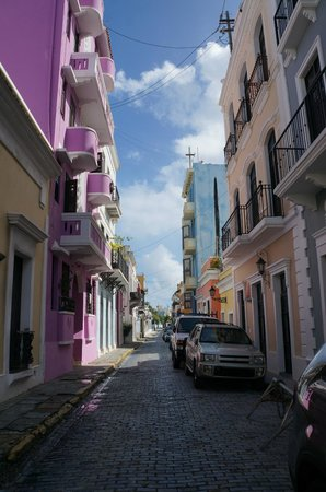 La Terraza de San Juan: Street view, hotel on right, directly across from pink building