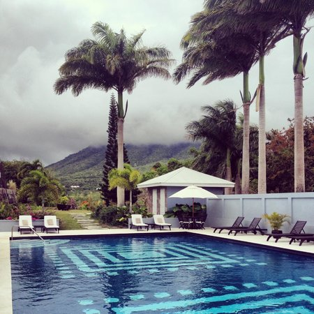 Montpelier Plantation & Beach: Lounging by the pool with a view of Nevis Peak.
