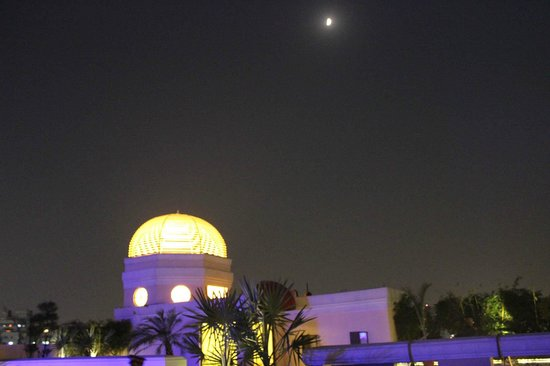 The Pllazio Hotel - moon rises over the Dome, swimming pool area on the roof-top
