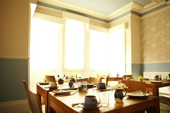The Waves: Dining Room with handmade tables and crockery