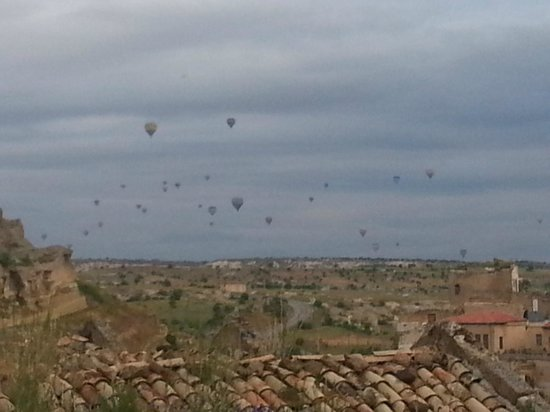 Perimasali Cave Hotel - Cappadocia: A view of the hot air balloons in the distance ...