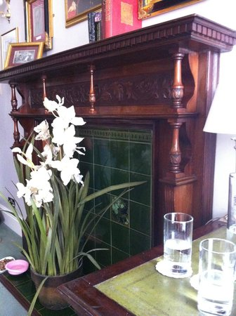 The Old Hall Hotel: Grand fireplace in room.