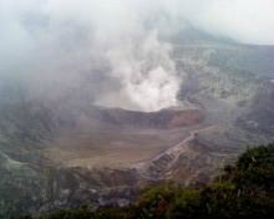 Poas volcano crater with steam