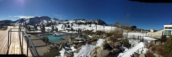 Squaw Valley Ski Area: The pool at el. 8200' surrounded by snow capped mountains