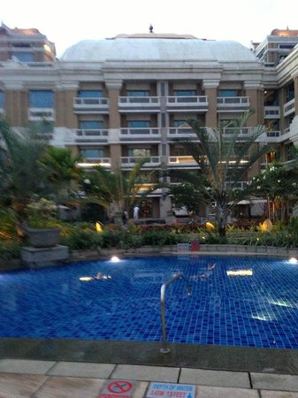 View of the hotel from swimming pool picture of itc Itc grand chola chennai swimming pool