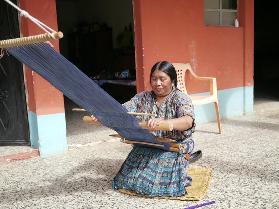Thirteen Threads Fair Trade Store and Maya Women's Center: one of the OB ladies weaving a FAIR TRADE item on a backstrap loom