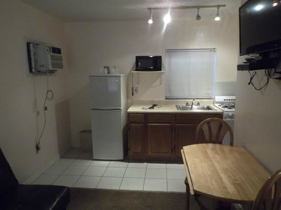 Sunnyside Motel: The Kitchen. with a fridge, an oven.