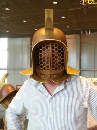 LVR-Archäologischer Park Xanten: Trying on a gladiator helmet in the museum