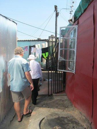 Siviwe Township Tours: Walking through through housing area....