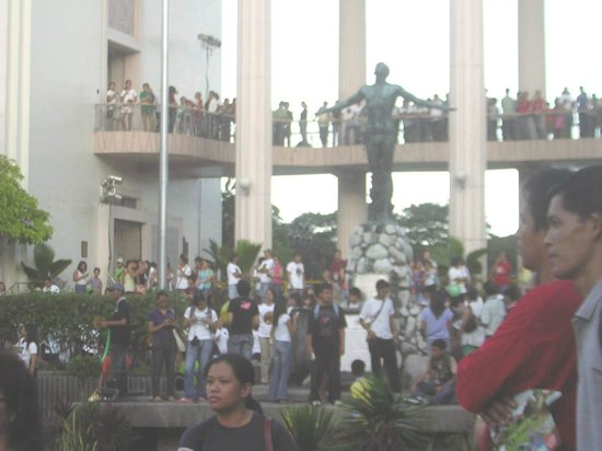 University of the Philippines: Famous Oblation at  Quezon Hall with crowd celebrating the University's Centennial 2008