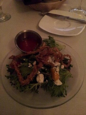 Ivory Grille : This is the house salad. It has grrens with wine soaked pears, mandarin oranges, strawberries, b
