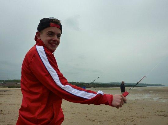 Traeth Lligwy: Flying the kite on the beach,great fun.