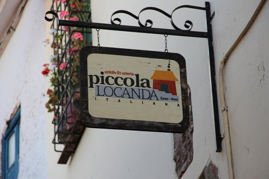 Piccola Locanda: The sign out front... you just ring the doorbell and someone lets you in...