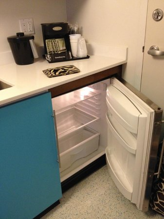 Small Kitchenette With Dual Pod Coffee Maker And Mini Fridge