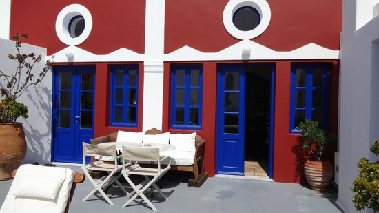 Ikies - Traditional Houses: on private patio, in front of Collector's House rooms/suite