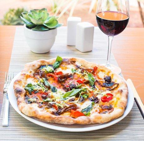 Pinzimini: Enjoy brick oven pizza and a glass of wine!
