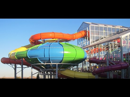 Water-Zoo Indoor Water Park: Slide inside a twisting turning storm full of surprises.  The 2 four story water slides plus a b
