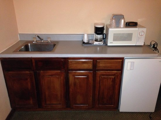 Blue Spruce Motel: Counter with sink/coffee maker/fridge/microwave counter. On left is bathroom, on right are hange