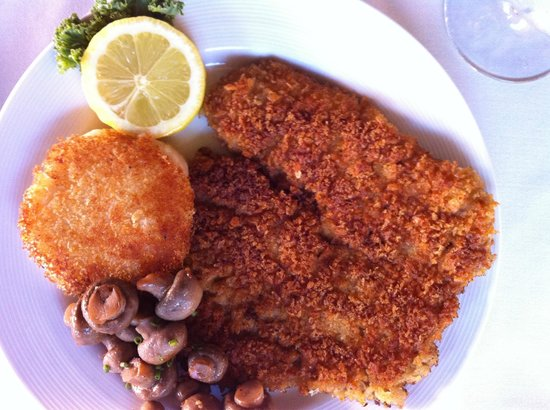 Cafe Coconut Cove: Wiener Schnitzel $24 Veal Cutlet, Breaded and Sautéed, Sautéed Mushrooms, Vegetable, Potato Puff