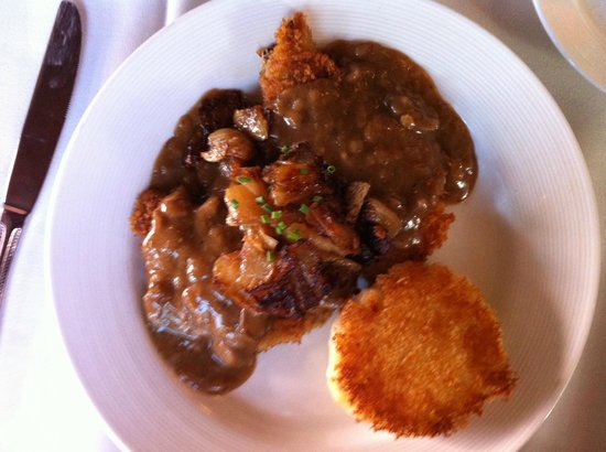 Cafe Coconut Cove: Jäger Schnitzel $21 Medallions of Pork Tenderloin, Breaded and Sautéed, Mushroom and Onion Gravy