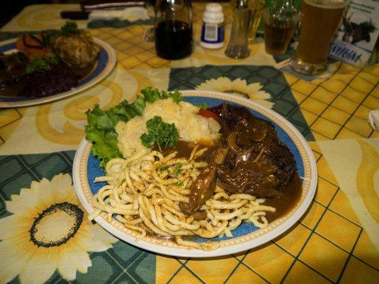 Charly's Bar & Restaurant : Guardatinaja with Swabian Spaetzle , Swabian Kartoffelsaltat & cranberry