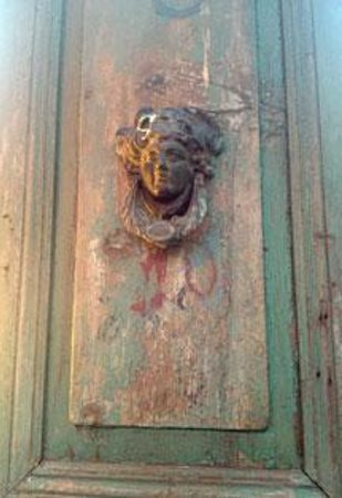 House of Medusa : Detail of one of the antique doors on the patio fence