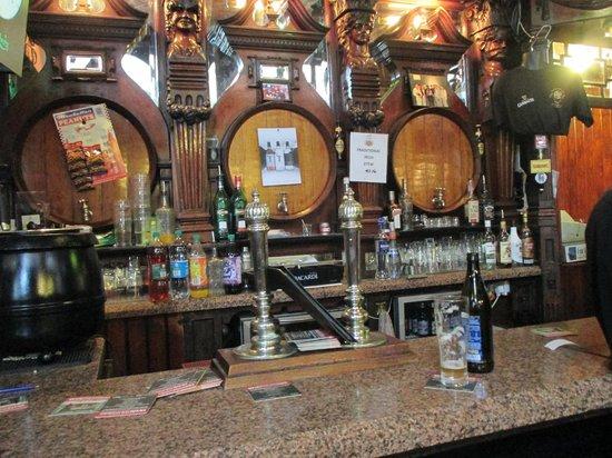 The International Bar: Wooden kegs at the bar