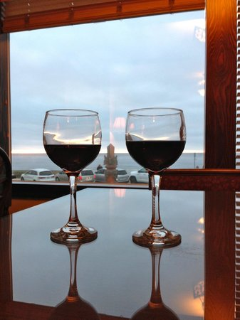 Pantai Inn: Glass of wine overlooking the sunset