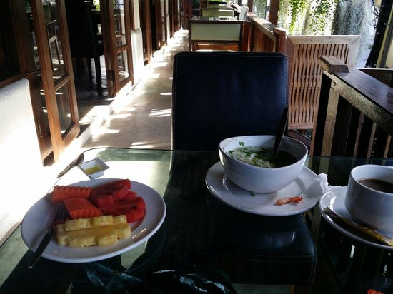 Restaurant at Rom Po Boutique: Generous serving of boiled rice breafast with cut fruits, coffee, orange juice @ THB140.