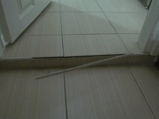 Demir Apart Home: Broken strip leading to shower room