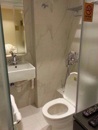 9 Boutique Hotel: The toilet- the metal faucet by the toilet is not a bidet it's the shower!