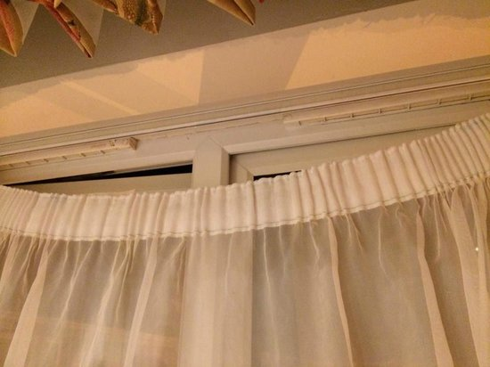 Whittlebury Hall : Net curtain falling down. Should be flush and horizontal