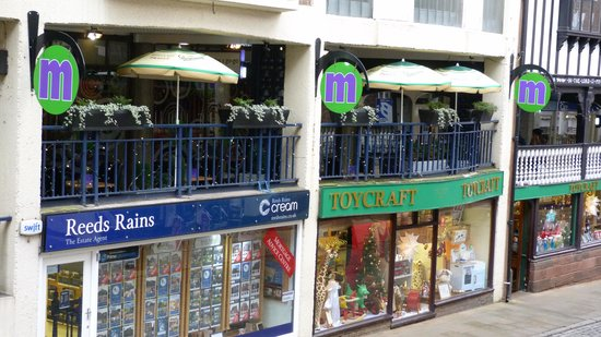 Moules A Go Go -: Tucked away in Watergate Row, but the signage and parasols help to get Moules a Go Go noticed