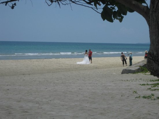 Nexus Resort & Spa Karambunai : somebody taking wedding photos on the beach