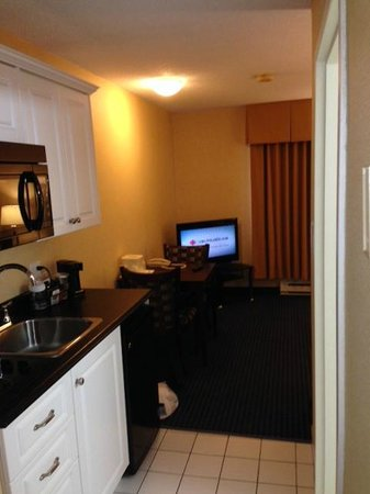 Comfort Inn: View of kitchenette and living area from sleeping area and entrance.