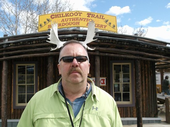 Chilkoot Trail Authentic Sourdough Bakery : hubby with his antlers.  taken by our tourguide, dyea dave
