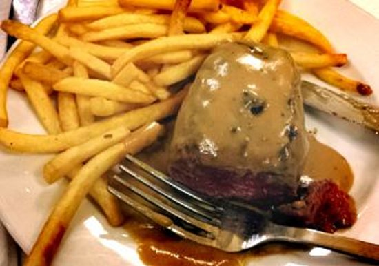 Le Bouillon Chartier : Rare, tender Steake Hache, sauce Poivre vert and frites
