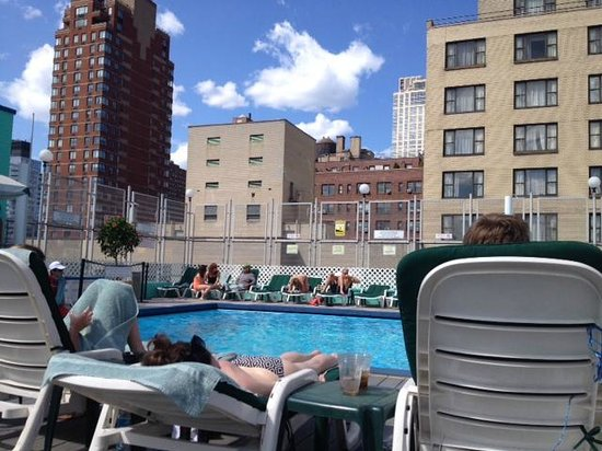 The Watson Hotel : rooftop pool. plenty of lounge chairs plus there's a bar