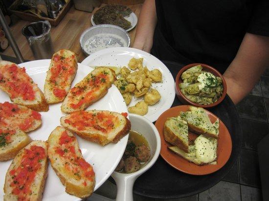 The Village Table: Selection of tapas- pan tomate, popcorn shrimp, artichoke hearts, potato tortilla