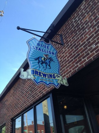 Blue Stallion Brewing Company: Blue Stallion sign hanging above front door.
