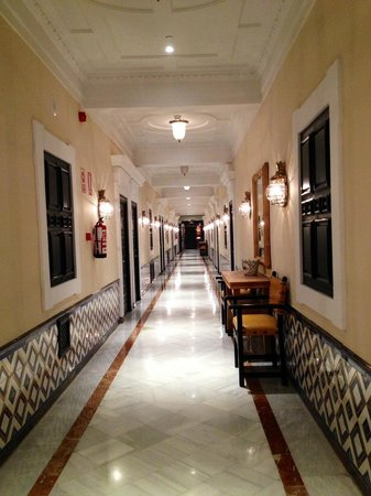 Hotel Alfonso XIII, A Luxury Collection Hotel, Seville: Corridor to rooms Level 2.  Beautiful marble and tiles.  Imagine what the rest of the hotel is l